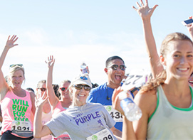 Runners waving during a race