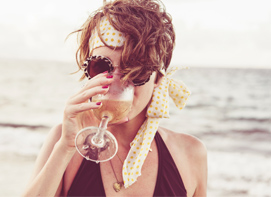 Women at Beach With Wine