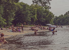 People Playing at River