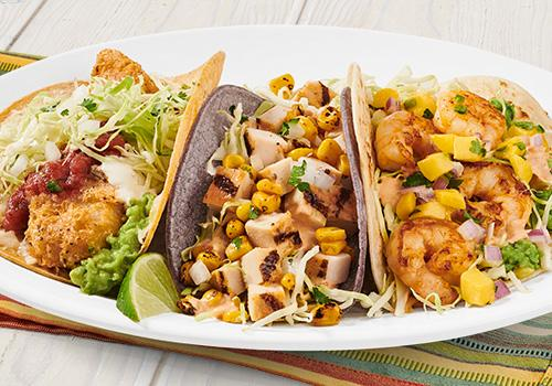 Baja Trio at Rubio's includes: Fish Taco Especial, Mango Shrimp Taco, Chicken & Fire-Roasted Corn Taco