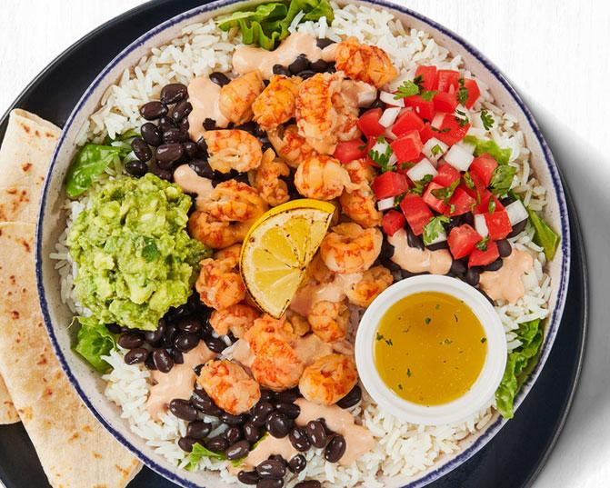 Sustainably sourced, wild-caught Langostino Lobster Bowl with citrus rice and black beans