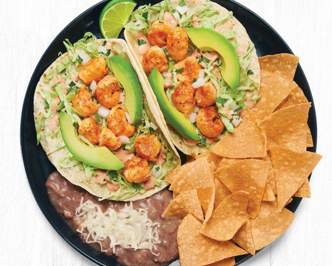 """Sustainably sourced, wild-caught Langostino Lobster Two Taco Plate with """"no-fried"""" pinto beans and tortilla chips"""
